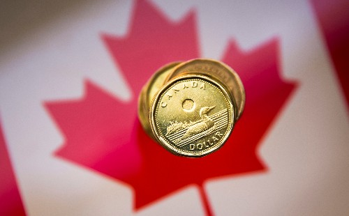 Canadian dollar near flat ahead of federal budget, Fed rate decision