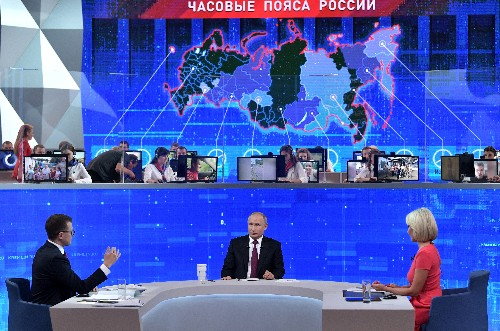 As ratings drop, Putin defends record, says better life awaits Russians