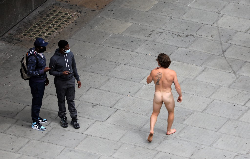 Man parades down Oxford Street wearing nothing but mask