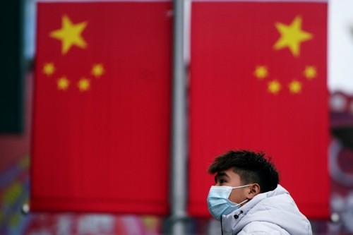 China heads into Lunar New Year on shutdown as virus spreads to Europe