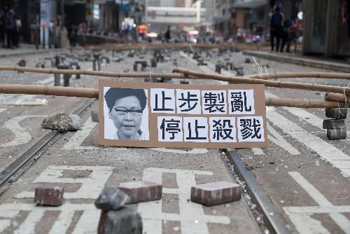 Protesters blockade universities, stockpile makeshift weapons as chaos grips Hong Kong