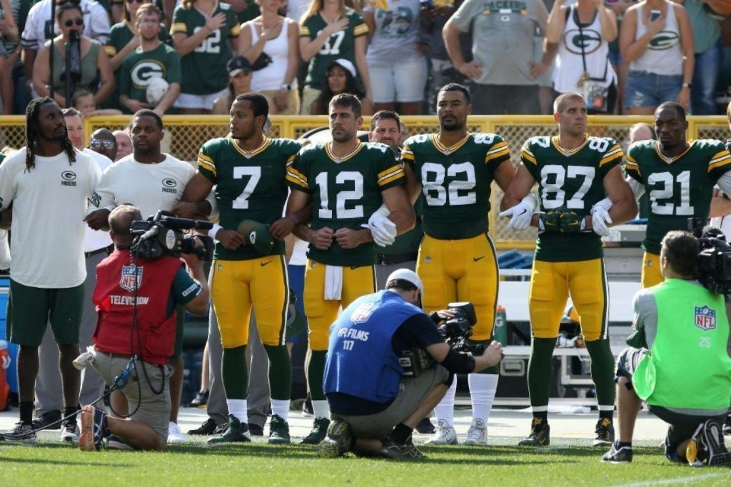 Trump remains on the attack against the NFL as Aaron Rodgers and the Packers ask fans to link arms