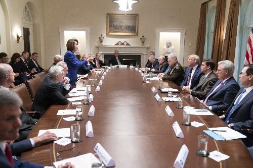 About that photo: Trump, Pelosi clash amid impeachment