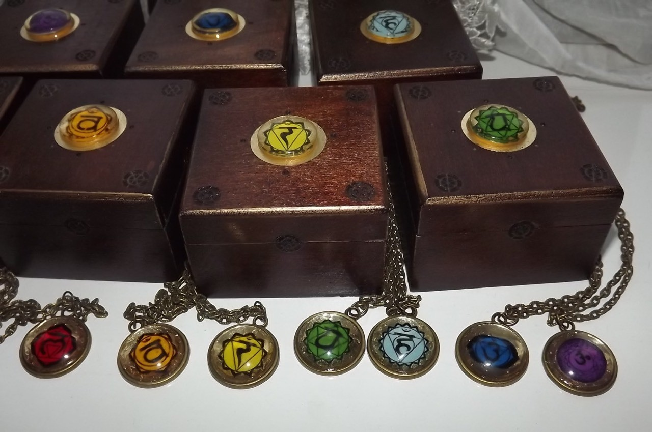 set of mini chakra boxes with matching chakra pendants. #chakras #chakra_symbols #spiritual #metaphysical