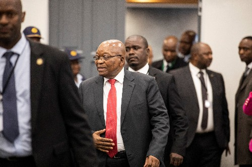 Defiant at inquiry, South Africa's Zuma denies breaking law with business brothers
