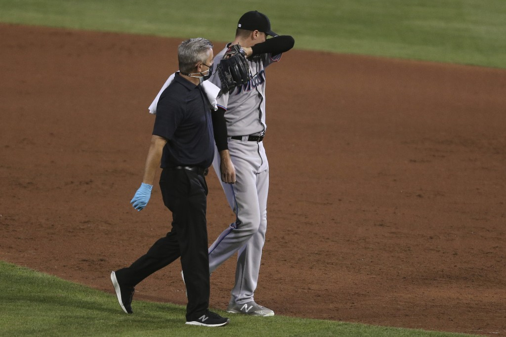 Marlins finally get to go home after beating Blue Jays 14-11