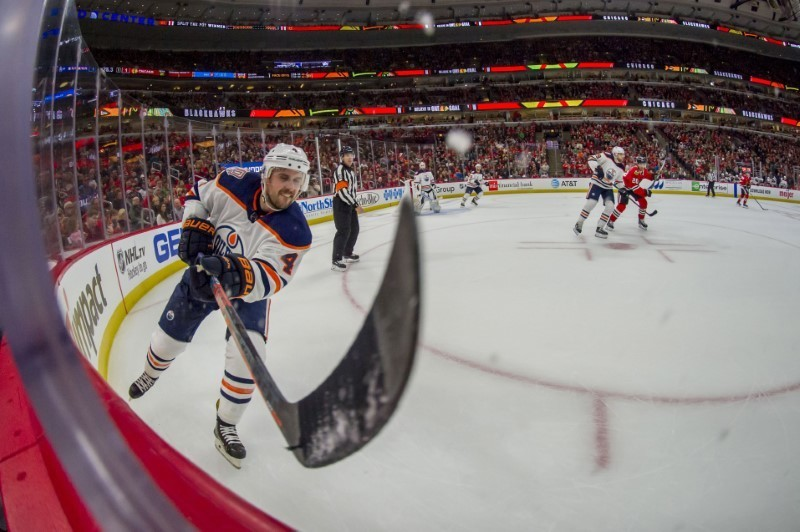 Oilers ink D Russell to contract extension