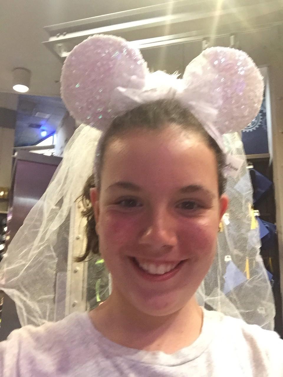 Aly having fun in the Disney hat store