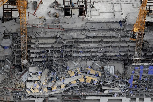 The Latest: 2nd person dead in building collapse