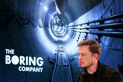 Tesla shares fall after CEO Musk abuses British caver