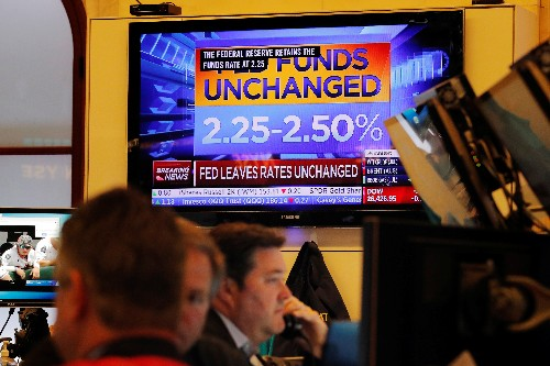 Stocks approach record as Fed soothes Wall Street's fears