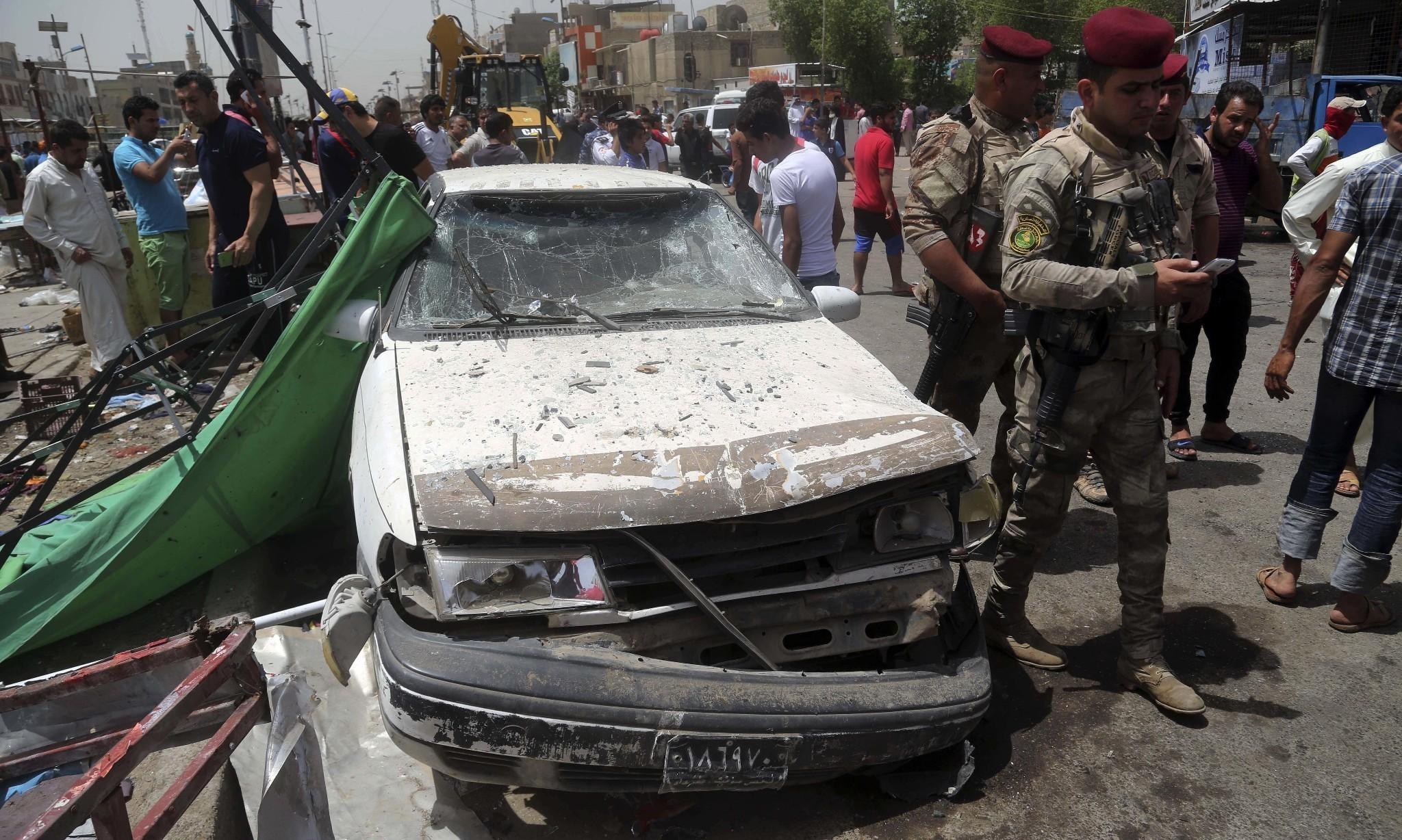 Baghdad market car bomb attack kills dozens