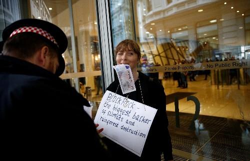 Climate change activists target BlackRock offices in London