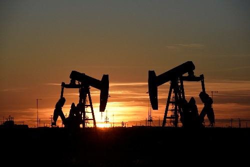 Oil prices hold steady amid Mideast tensions, weak economic data