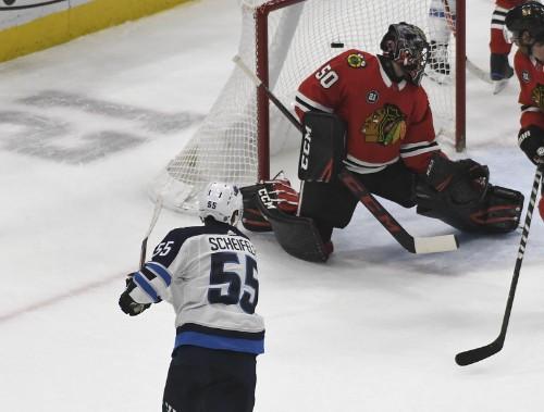 Red-hot Jets drop struggling Blackhawks in OT
