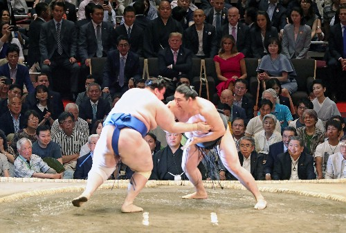 Trade put to one side, Trump and Abe do diplomacy over golf and sumo