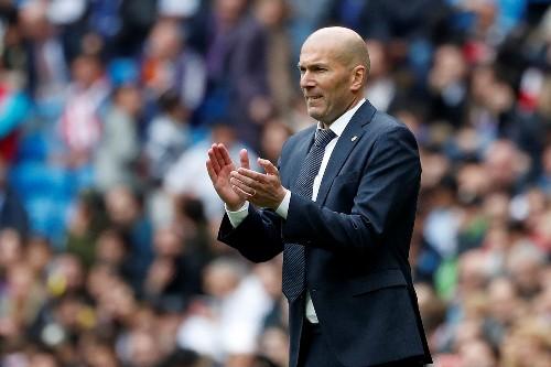 Soccer: Zidane hails hat-trick hero Benzema as world's best nine