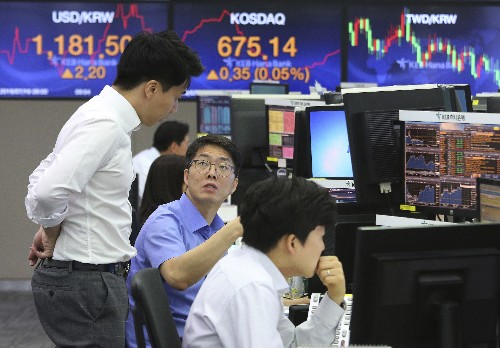 Asian shares little changed, mixed in lackluster trading