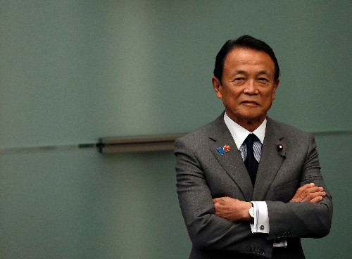 Japan finance minister watching coronavirus impact, to ensure fiscal policy steps