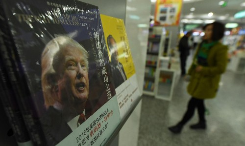 China threatens to cut sales of iPhones and US cars if 'naive' Trump pursues trade war