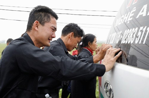 Vietnam police charge seven over Britain truck deaths