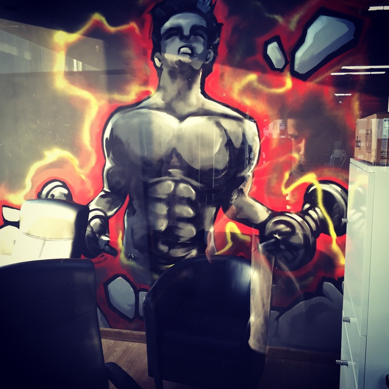"Personal trainer at Elevation fitness, JLT Y cluster, Dubai. This is where my journey as a personal trainer begins. We are gonna be holding calisthenics beginners and Brazilian jiu jitsu beginners group classes. Really excited and looking forward to the hard work. By the way this is an awesome graffiti at the Business Bay branch at the tower called ""One by omniyat"" ."
