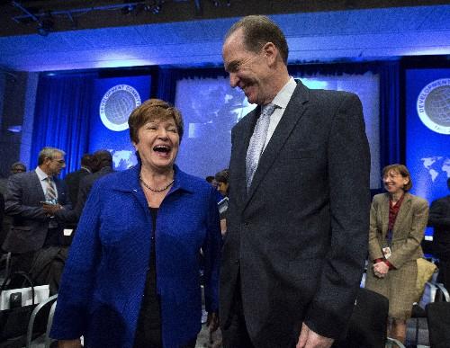 Finance officials pledge to combat global economic slowdown