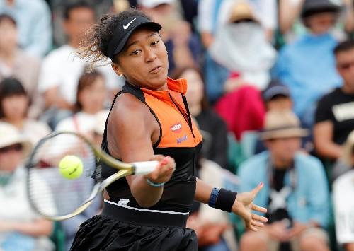 Frustrated Osaka battles past Pegula in Beijing opener