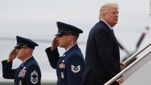 Besieged at home, Trump sets off for 'do-or-die' foreign trip