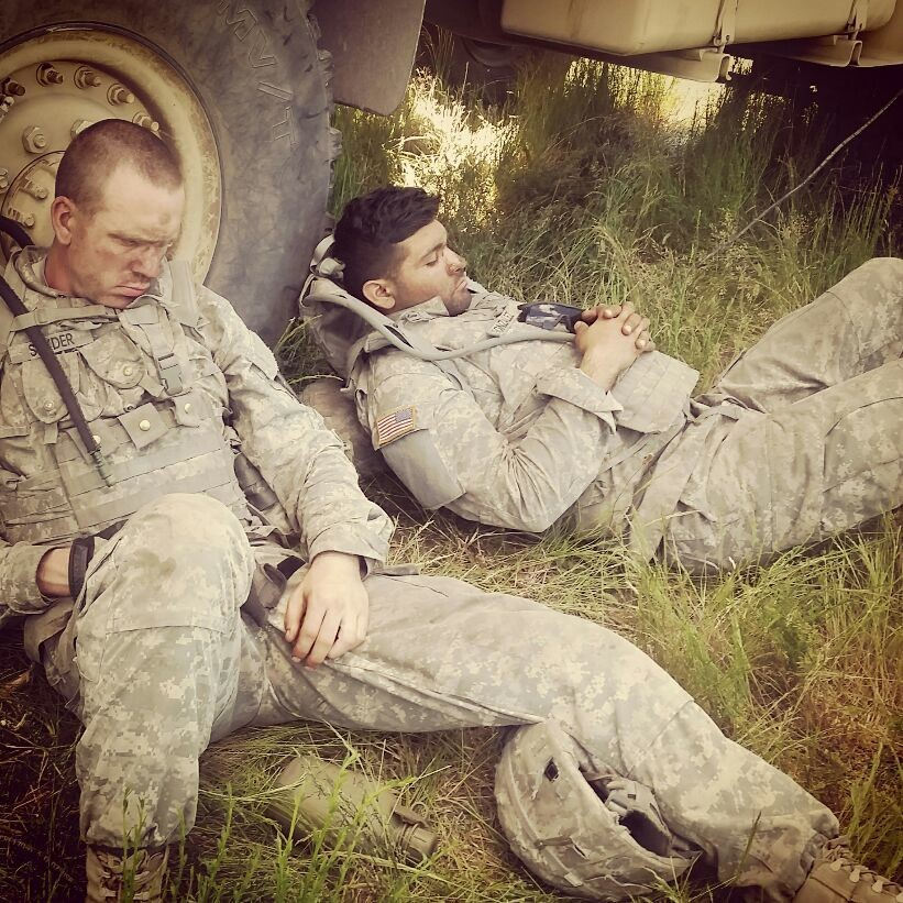 Two soldiers getting rest while they can between occupations
