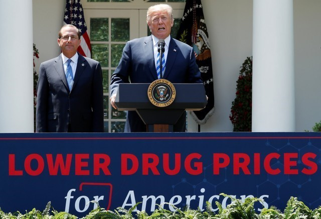 Trump assails high drug prices, avoids direct hit on industry