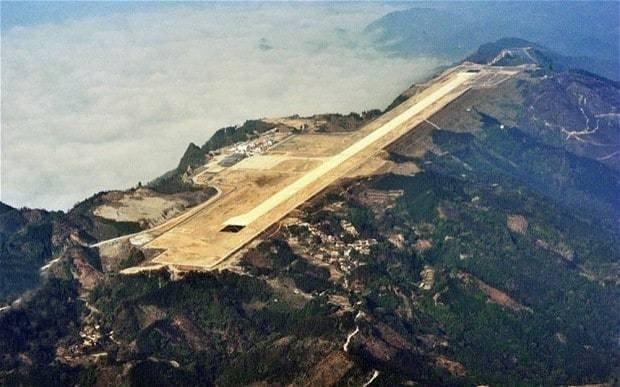 China dynamites mountain tops for Hechi airport in the sky