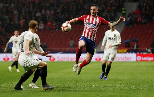 Soccer: Atletico put Barca celebrations on ice with win over Valencia