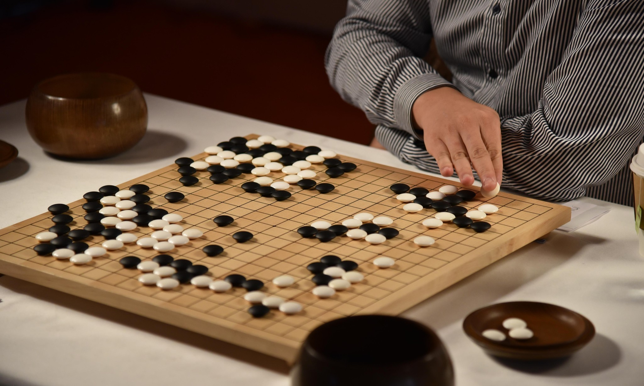 Google AI computer beats human champion of complex Go boardgame