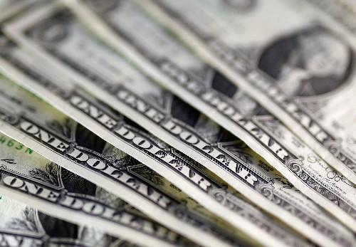 Dollar slips on Fed prospects; safe-haven Swiss franc, gold shine