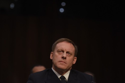 Top intelligence official told associates Trump asked him if he could intervene with Comey to get FBI to back off Flynn