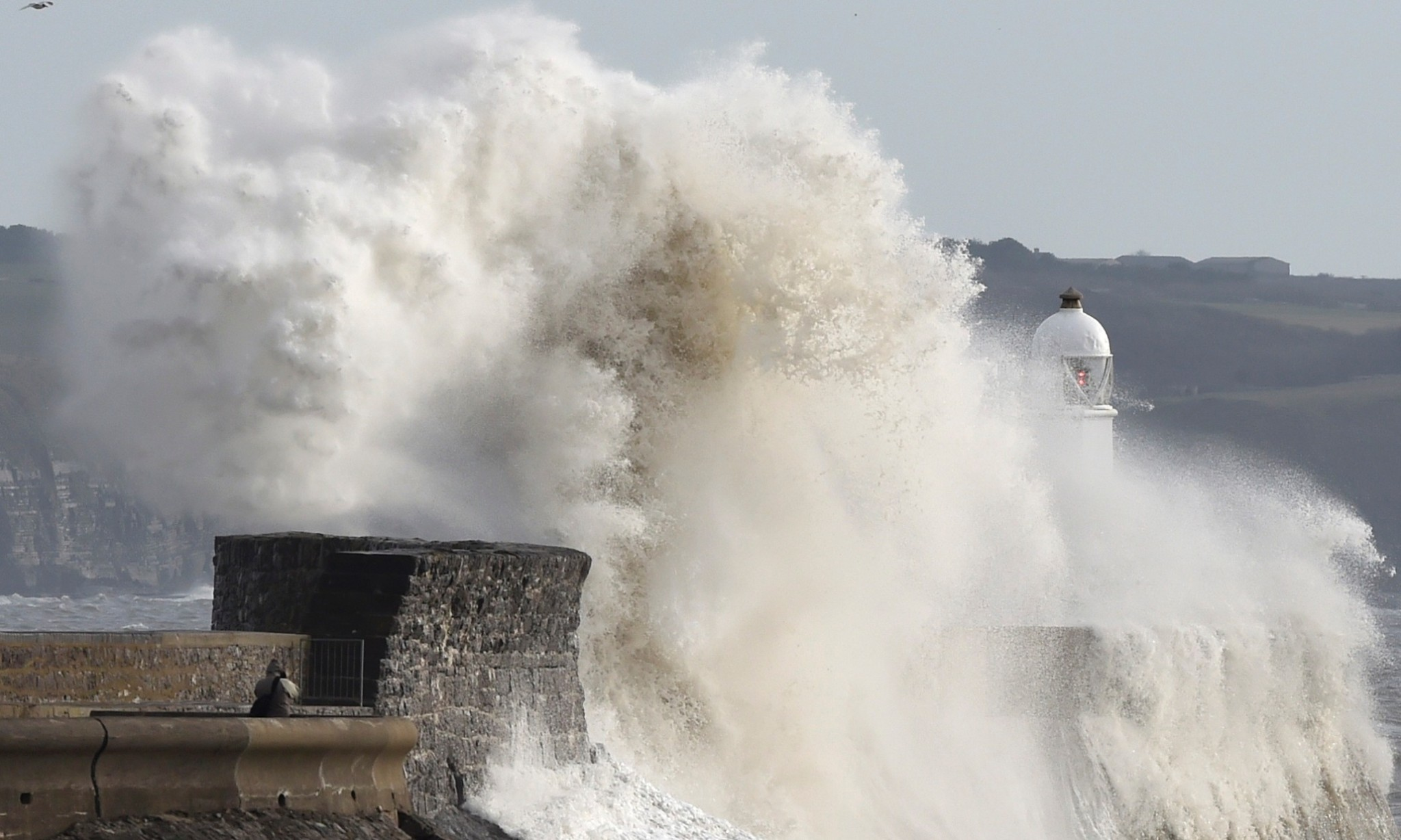 Gales and heavy rain cause floods and travel chaos across the UK