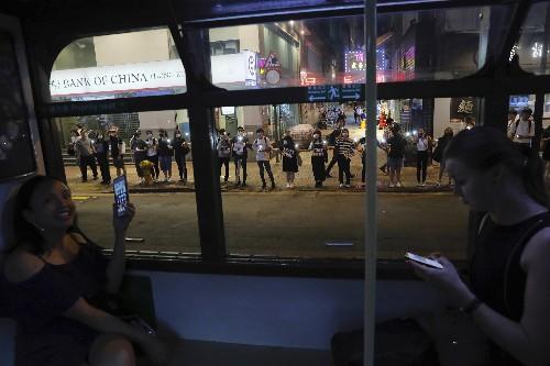 Canada halts Hong Kong consulate staff travel after UK case