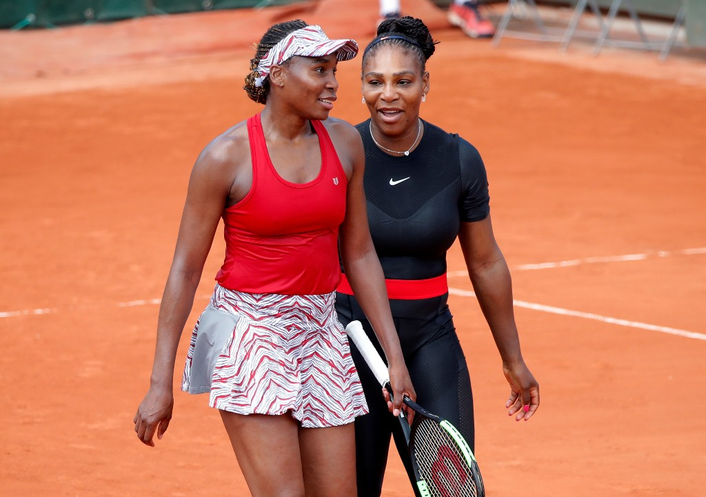 WTA roundup: Williams sisters set up second-round meeting