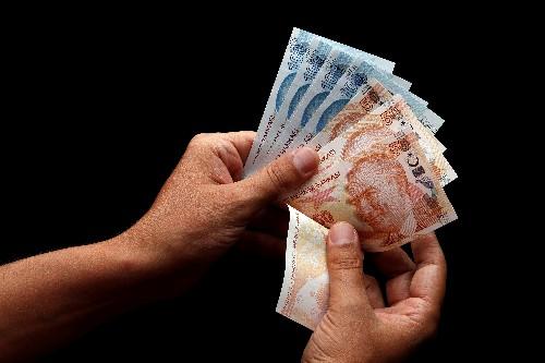 Turkish lira firms nearly 1% against dollar after Turkey-U.S. deal on Syria