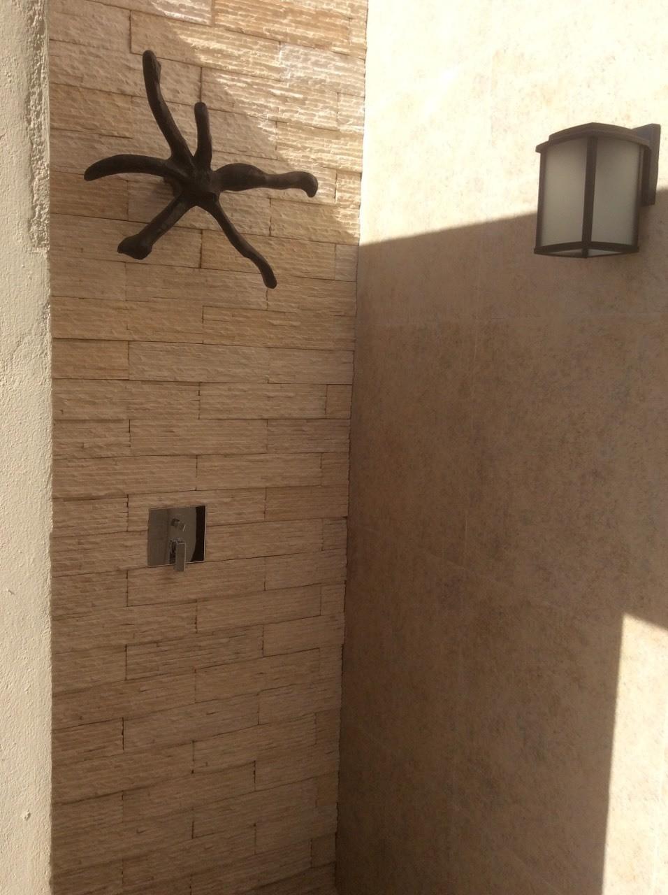 Outdoor shower in the Over Water Suites at El Dorado Maroma