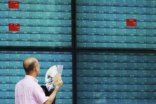 World shares mostly dip as China, US to resume trade talks