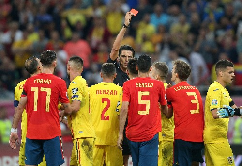 Soccer: Spain survive Romania onslaught to secure fifth win