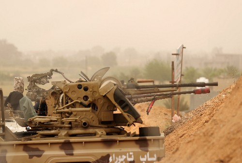 Tripoli forces push opponents back slightly south of Libyan capital-witnesses