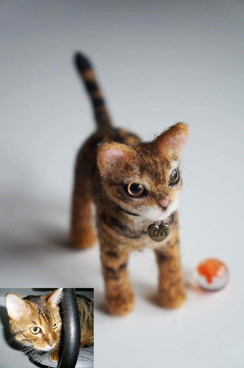 A Bengal cat I felted from photos. Made of wool, plastic eyes and wires.