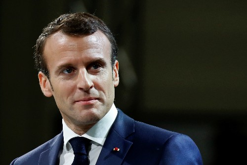In Versailles, Macron vows to reform to avoid king's fate