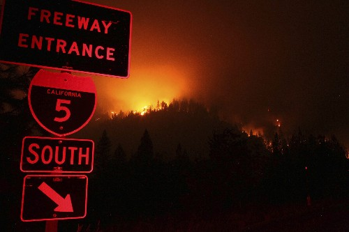 Wildfire that closed key California highway explodes in size