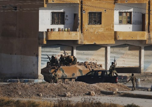 The Latest: Syrian Kurds ally with Damascus in major shift