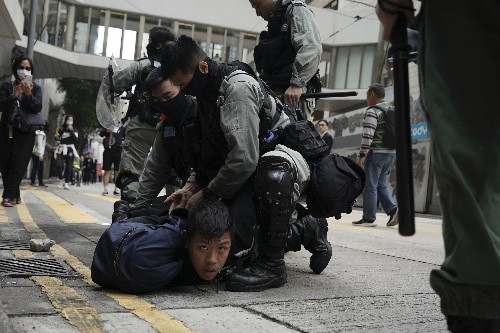 Thousands-strong Hong Kong protest cut short by clashes