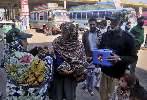 Bomb kills Pakistani policeman assigned to anti-polio team